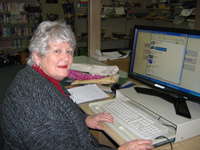 This volunteer assists in the school library.